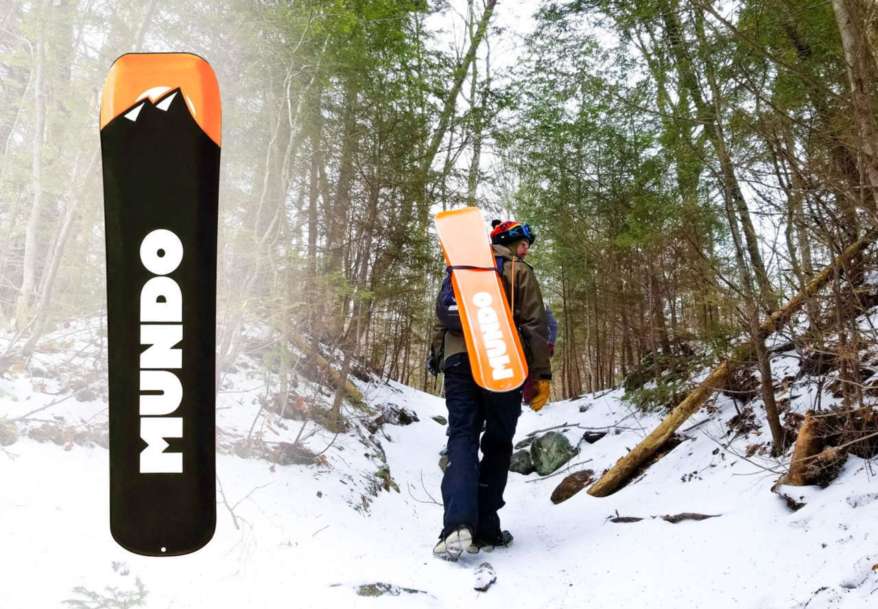 Mundo Trailboard being walked up trail