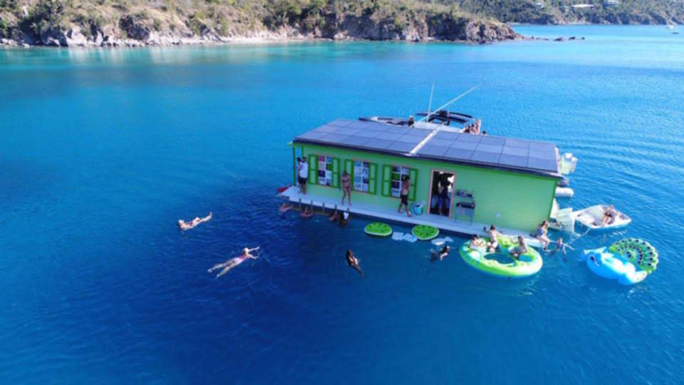 A boat serving tacos and cocktails is floating on the Caribbean
