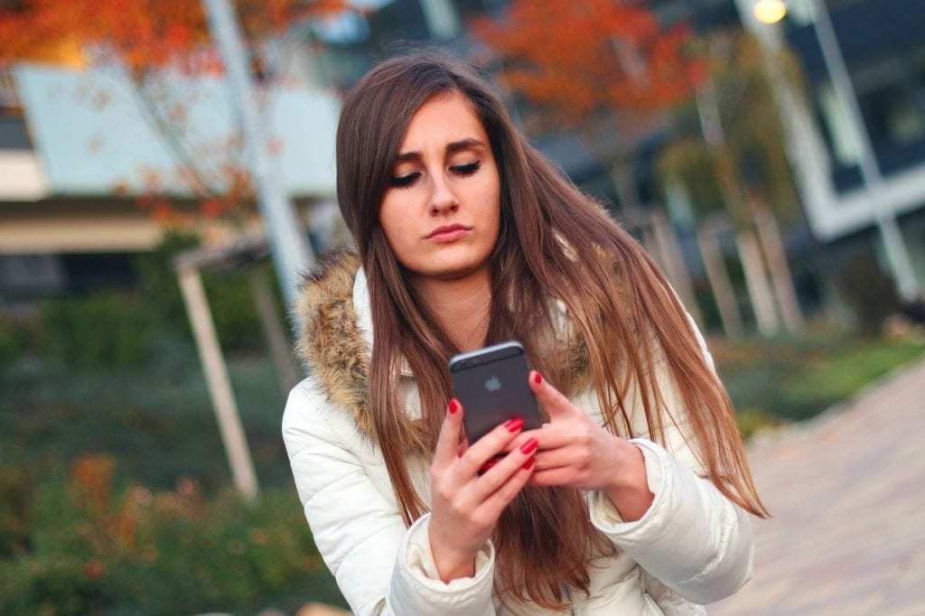 Woman uses slide right function on smart phone