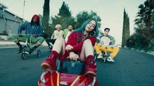 Billie Eilish rides a big wheel in her music video
