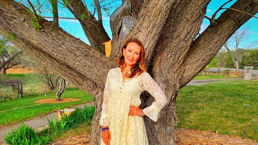 Adriana Monique Alvarez Standing by a tree