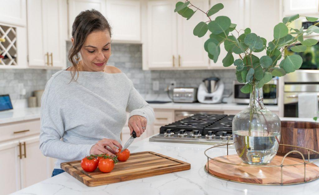Dana Kay cutting salad